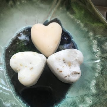 BombusLeaf Heart shaped Hand and Body Soap Scrubs on a green soap dish