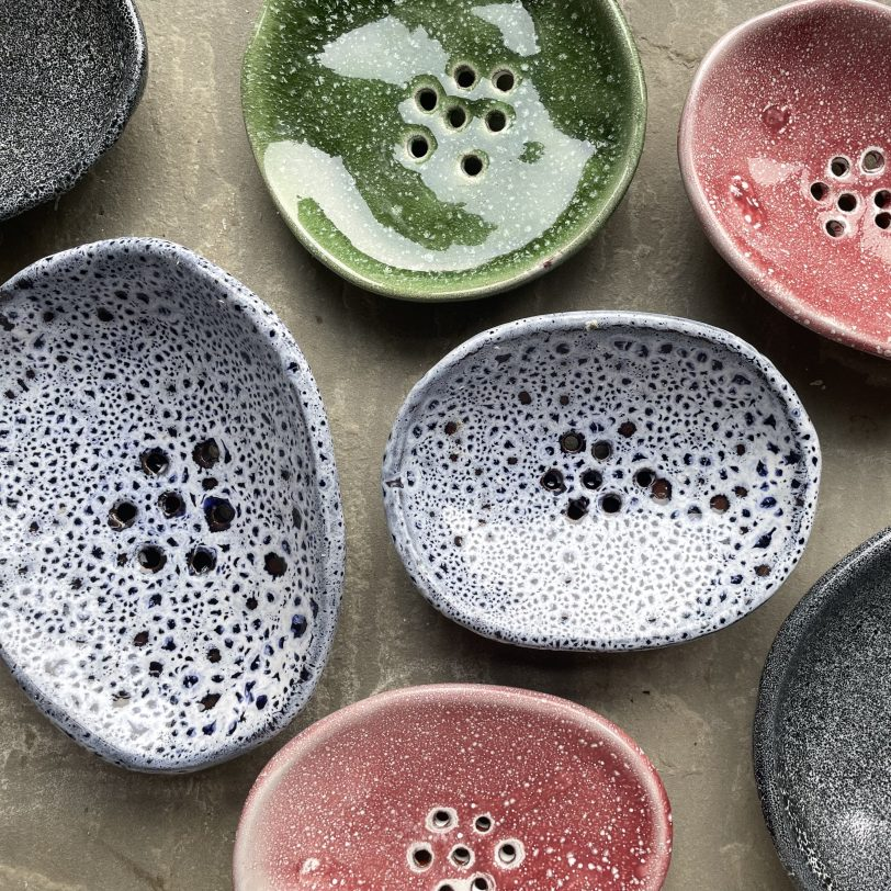 Variety of colourful soap dishes